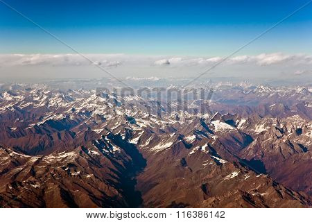Beautiful View From The Aircraft To The Mountains Of The Himalaya On Chinese Tibetan Side Snow