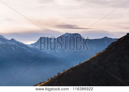 Scenic Cloudscape Over Majestic Mountain Range At Sunset
