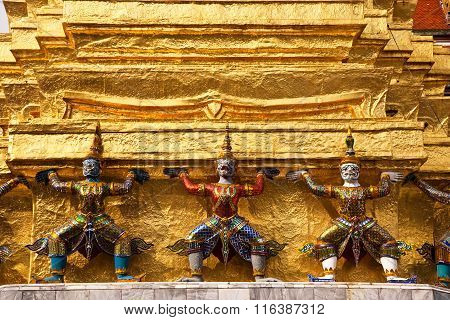 BANGKOK, THAILAND - APR 3, 2012: Karyatide at the gold Chedi in the Grand Palace. The Grand Palace is the main tourist attraction in Bangkok.
