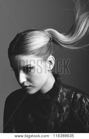 Blonde Woman Wearing Shirt With A Ponytail