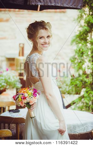 Smiling bride before wedding ceremony. Young girl
