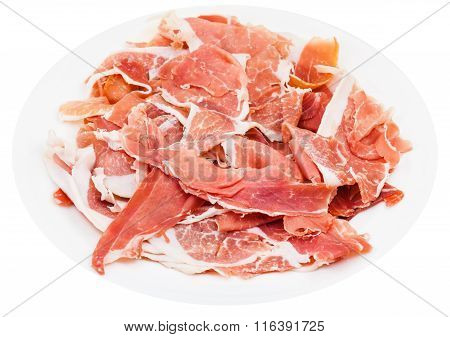Thin Sliced Uncooked Jerked Pork On Plate Isolated