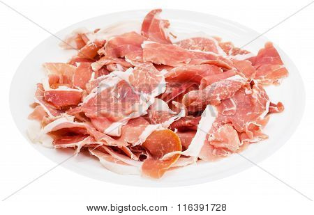 Many Slices Of Dry-cured Ham On Plate Isolated