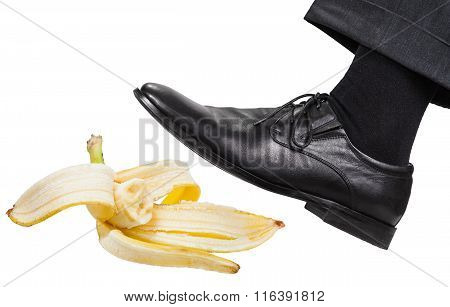 Leg In The Left Black Shoe Slips On A Banana Peel