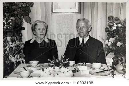 Vintage Photo: Husband And Wife Posing On The Anniversary Of Marriage