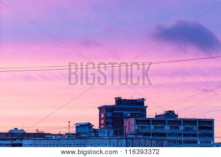 Blue And Pink Sunset Sky Over Houses In Winter