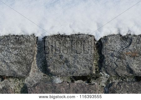 Granite Wall In The Snow