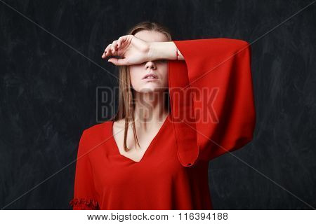 Close Up Portrait Of A Beautiful Sad Woman In Red Dress