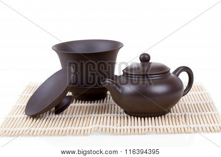 Chinese Ceramic Tea Set Bamboo Mat Isolated On White