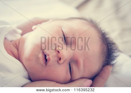 newborn baby lying on mother's hands symbolizing tenderness and care