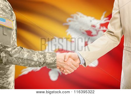 Usa Military Man In Uniform And Civil Man In Suit Shaking Hands With National Flag On Background - B