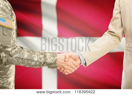 Usa Military Man In Uniform And Civil Man In Suit Shaking Hands With National Flag On Background - D