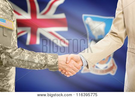 Usa Military Man In Uniform And Civil Man In Suit Shaking Hands With National Flag On Background - F