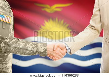 Usa Military Man In Uniform And Civil Man In Suit Shaking Hands With National Flag On Background - K