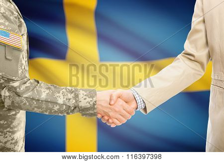 Usa Military Man In Uniform And Civil Man In Suit Shaking Hands With National Flag On Background - S