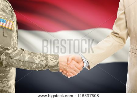 Usa Military Man In Uniform And Civil Man In Suit Shaking Hands With National Flag On Background - Y