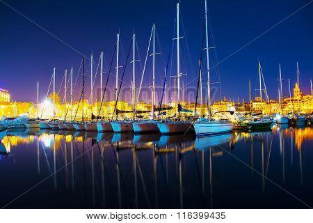 Boats In Alghero Seaport On A Clear Night