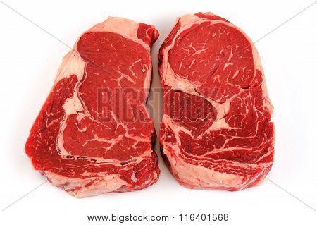 fresh raw rib eye steak on white background