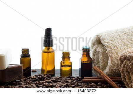 Natural Organic Soap Bottles Essential Oil And Sea Salt On A Wooden Table Coffee Background