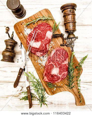 Raw Fresh Meat Rib Eye Steak With Herbs. Food Background