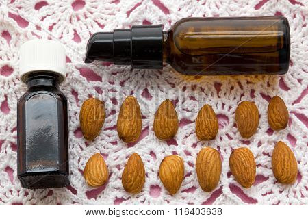Almonds And Oil On Pink Tablecloth