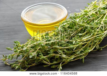 Fresh Cumin And Oil In A Glass Bottle On Wooden Background