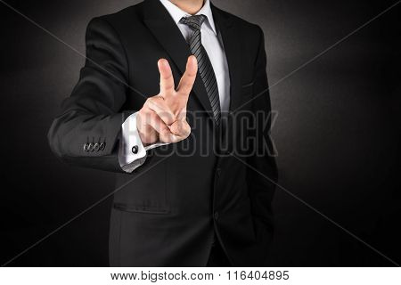 Business man make victory sign or two