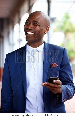 Smiling African Businessman With A Mobile Phone