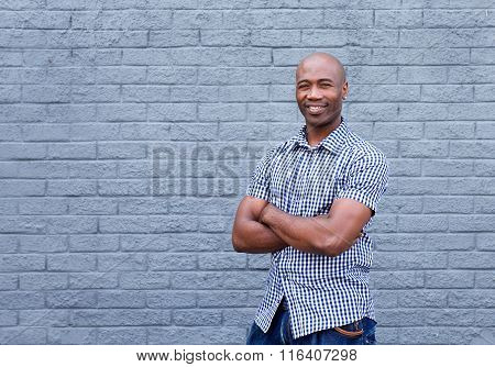 Smiling African American Man Standing With Arms Crossed