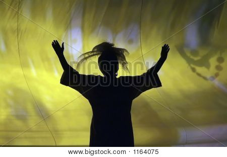 Silhouette Of Woman Singing