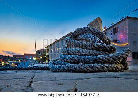 Wound Boat Rope On Mooring Bollard
