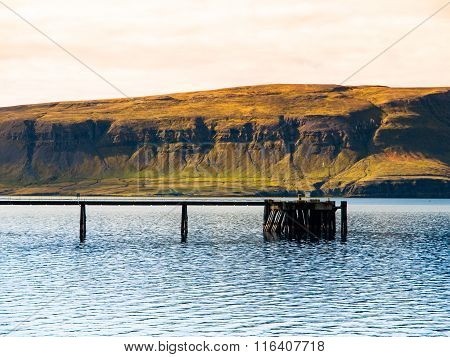 Wooden pier in the icelandic fjord