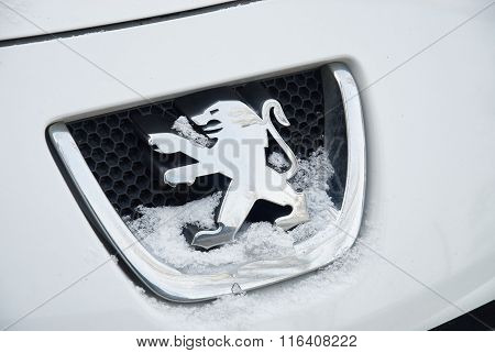 Logo Of Peugeot On Car Hood During Snowy Weather