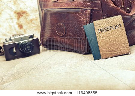 Bag and passport on the couch.