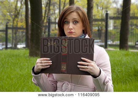 Beautiful Redhead Woman Girl Fooling Around With A Book In Park