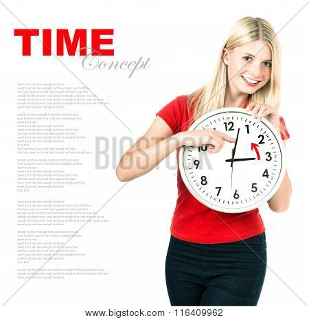 Young woman holding a clock. Time management concept. Winter time (Daylight Saving Time)