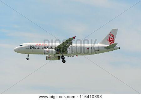 HONG KONG - JUNE 04, 2015: Dragonair aircraft landing at Hong Kong airport. Dragonair is a Hong Kong-based international regional airline
