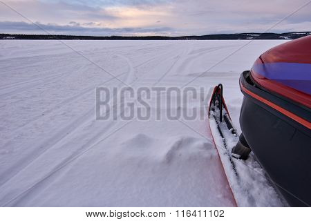 Snowmobile Ski And Frozen Lake