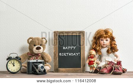 Doll, Teddy Bear, Chalkboard And Vintage Toys. Happy Birthday