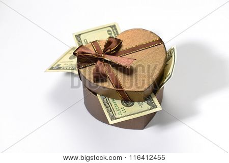 US dollar currency notes in the heart shape gift box. Valentine's Day cash reward or gift concept.