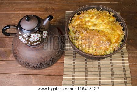 potato in a clay pot with cheese