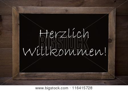 Chalkboard With Herzlich Willkommen Means Welcome