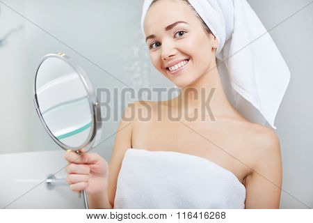 face of young beautiful healthy woman and reflection in the mirror