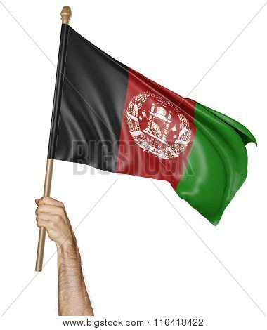 Hand proudly waving the national flag of Afghanistan