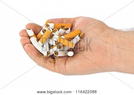 Broken cigarettes in hand isolated on white background