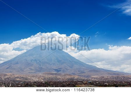 city and the volcano on a background of sky
