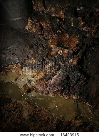 Severe oil pollution contaminates soil at an illegal oil mine in Java, Indonesia