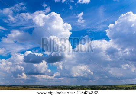 Summer Landscape With Green Grass And Clouds