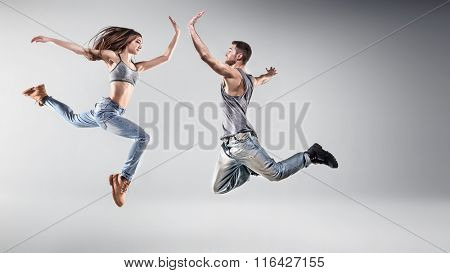 Young hip hop dancers, on studio background