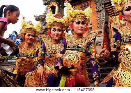 Female Balinese dancers pause during a dance performance in Ubud, Bali